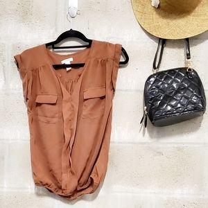 Semi sheer cap sleeve cinched blouse